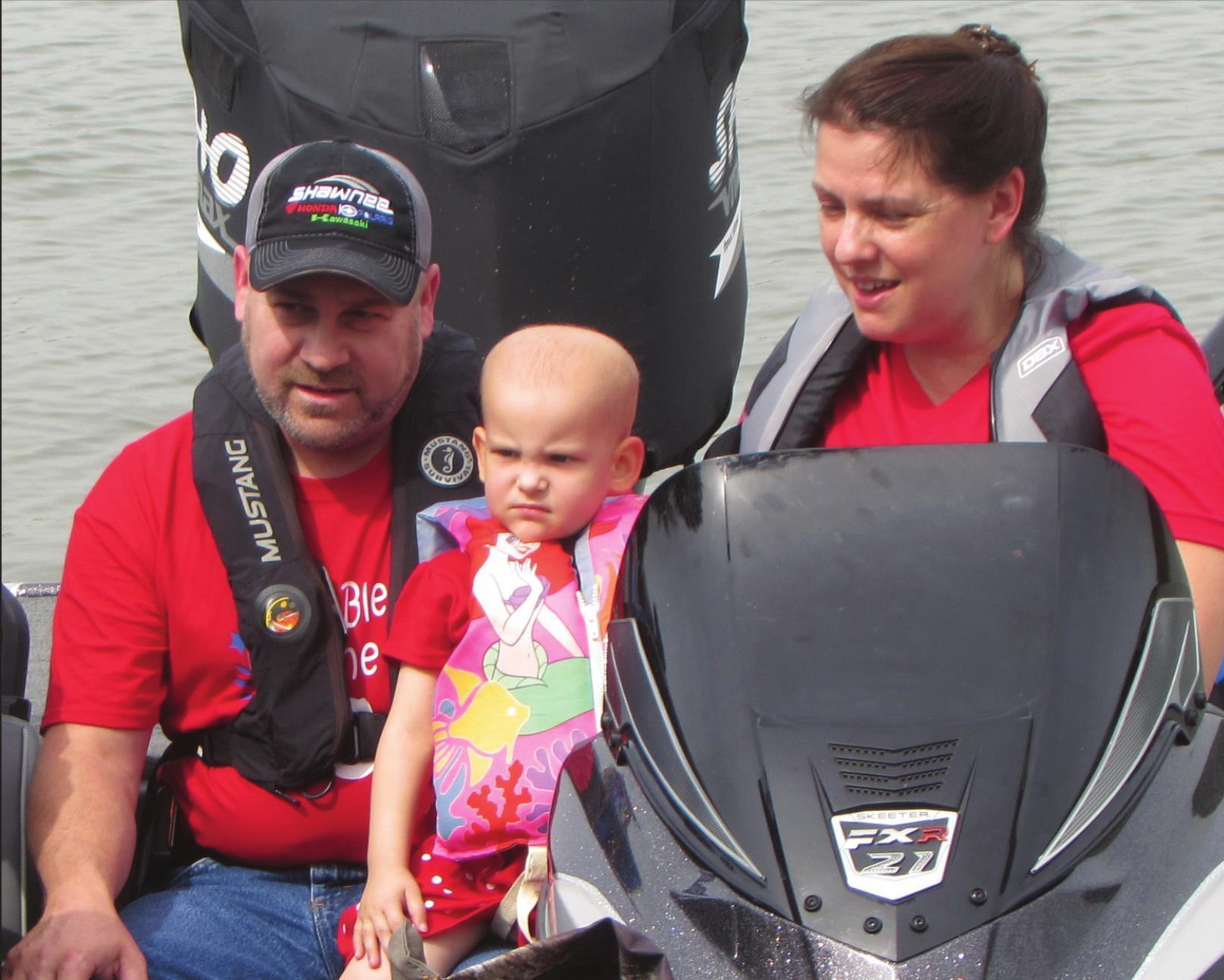 Millie with her parents, David and Courtney Mount. SHAUNA BELYEU   INDIAN JOURNAL